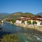 """The Mo Chhu flowing past the Punakha Dzong, or """"palace of great happiness."""""""