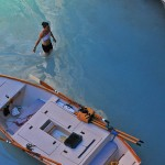 A boater wades through the turquoise waters at the mouth of Havasu Creek. Photo: Tom Gotchy