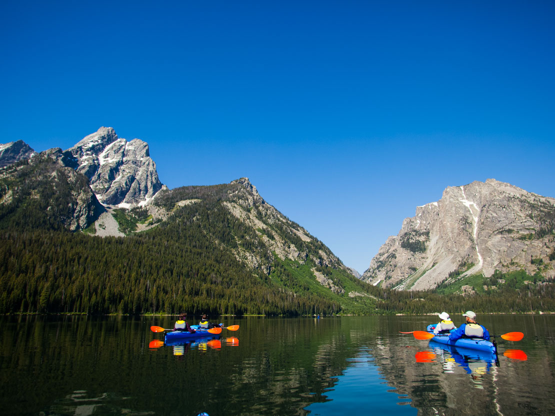 Sea kayaking Jackson Lake in Grand Teton National Park, WY.
