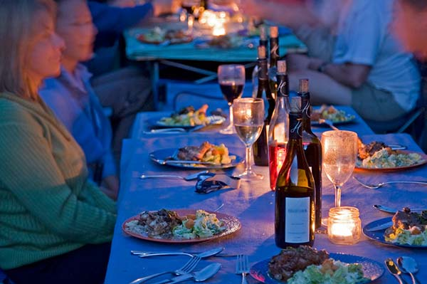 Gourmet dinner is paired with wine on the river